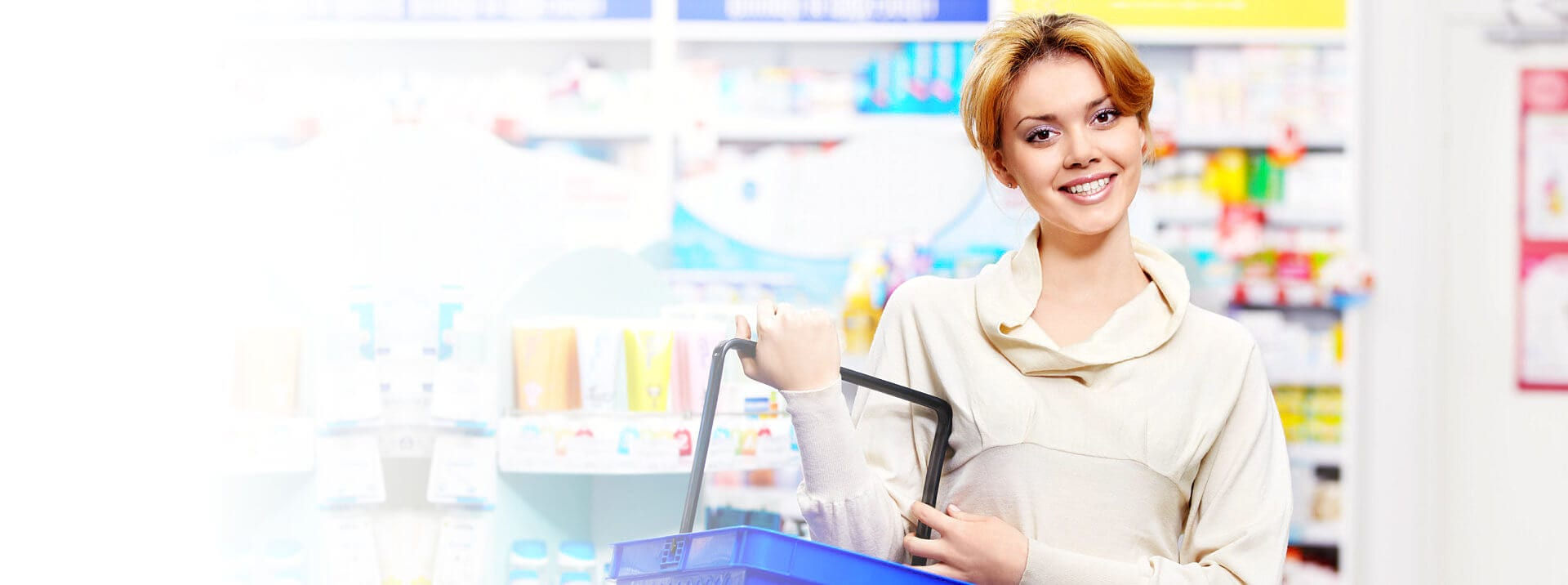 woman smiling at pharmacy